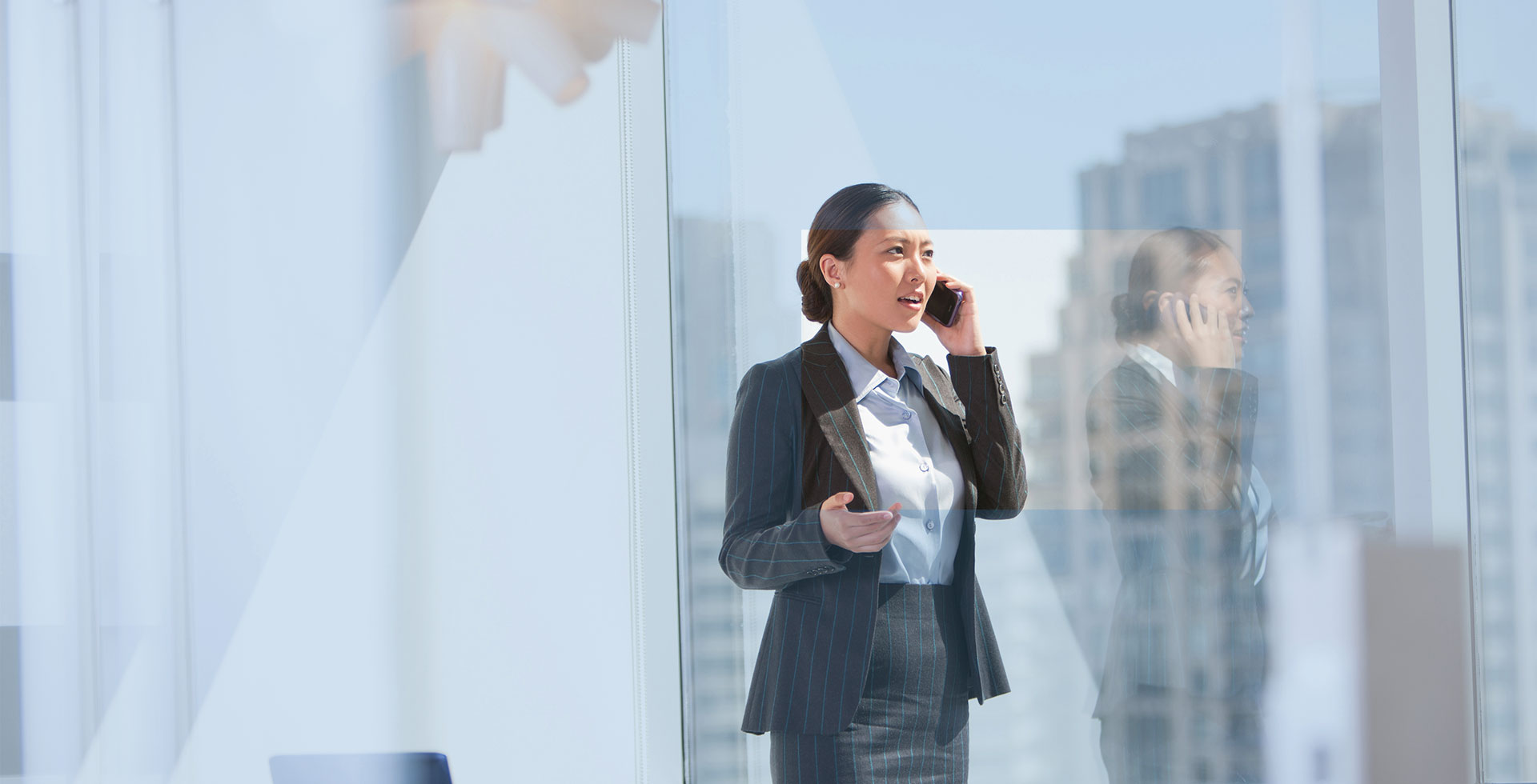 Business woman talking on her cell phone